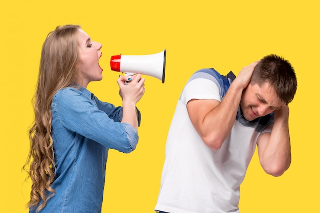 Woman shouting in megaphones at each other Free Photo