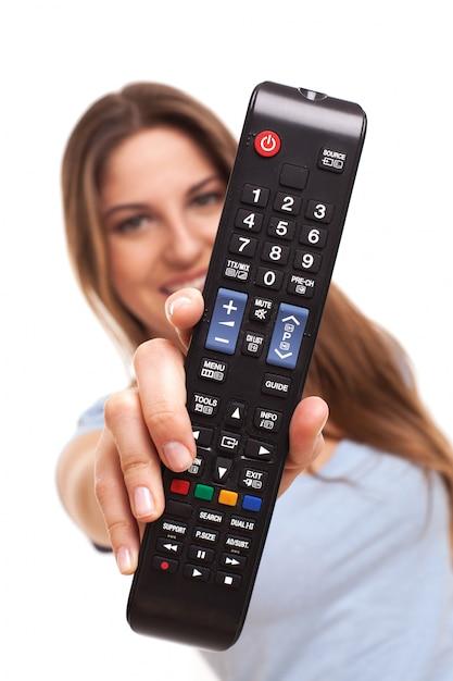 Woman show a remote Free Photo