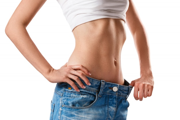 Woman showing her progress after weight loss Premium Photo