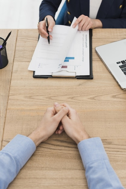 Woman showing man where to sign contract for new job Premium Photo