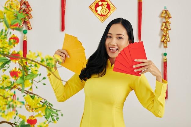Woman showing money envelopes Premium Photo