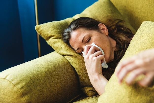 Woman sick on the sofa Premium Photo