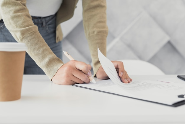 Woman signing a paper close-up Free Photo