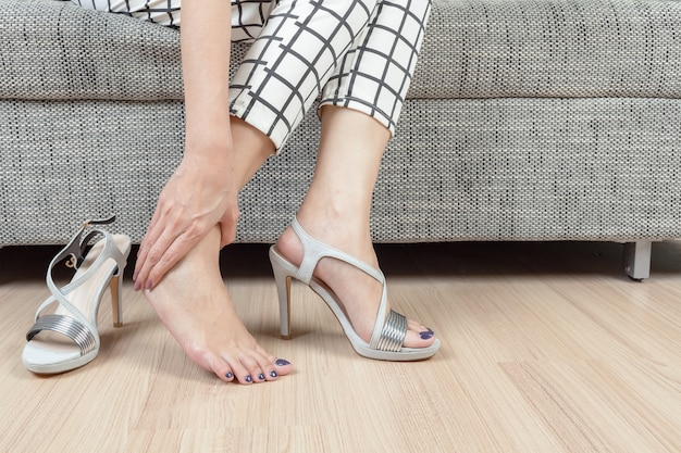 Woman Sit On Chair And Female Hand With Foot Pain After, Take Shoes Off  Premium