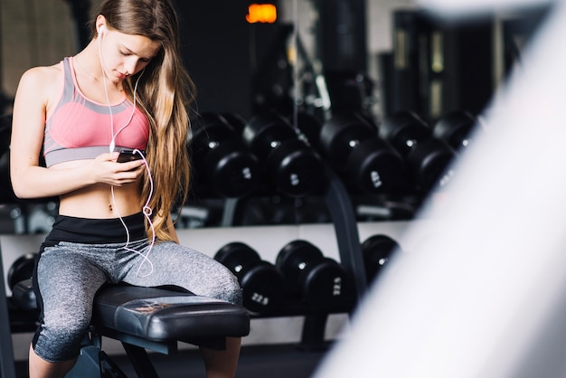 Woman sitting at gym Free Photo