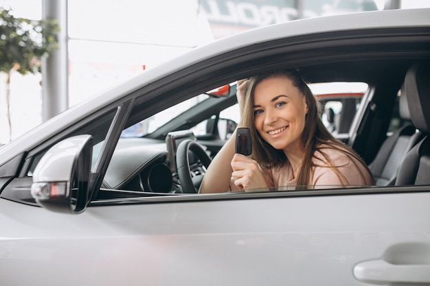 Woman sitting in a car Free Photo