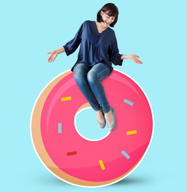 Woman sitting on a doughnut Free Photo