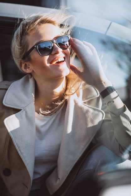 Woman sitting in electo car Free Photo