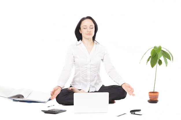 Woman sitting on the floor cross-legged Free Photo