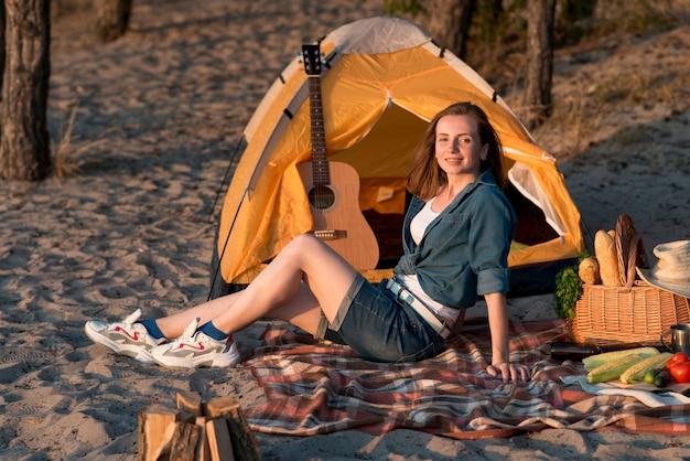 Woman sitting on picnic blanket Free Photo