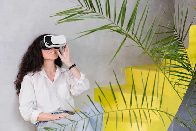 Woman sitting on the stairs using vr Free Photo