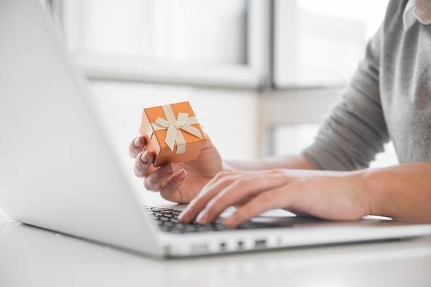 Woman sitting at table with laptop Free Photo