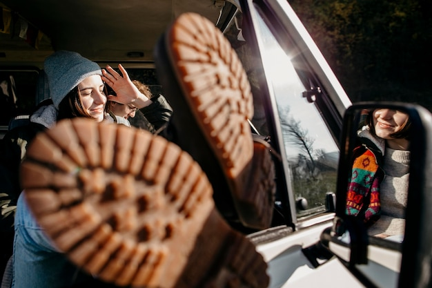 Woman sitting in a van with her legs out close up Free Photo