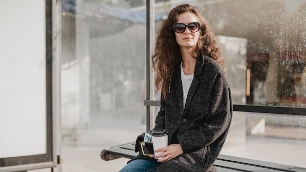 Woman sitting and waiting in the bus station Free Photo