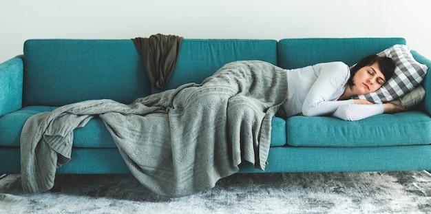 Woman sleeping on the sofa Premium Photo