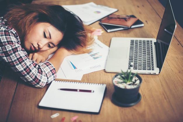Woman sleeping at work Free Photo