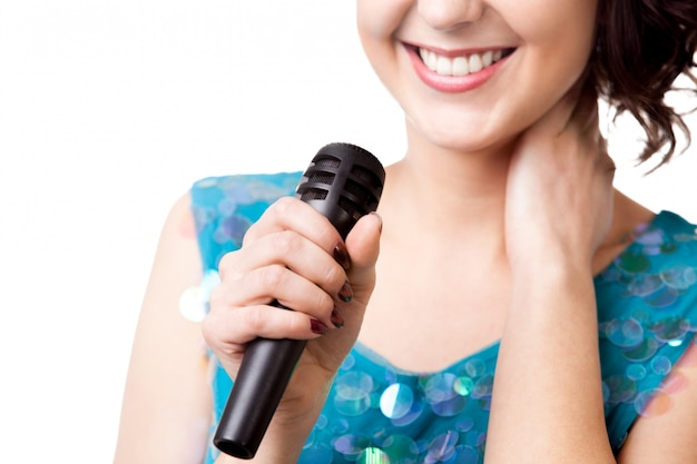 Woman smile and a microphone Free Photo