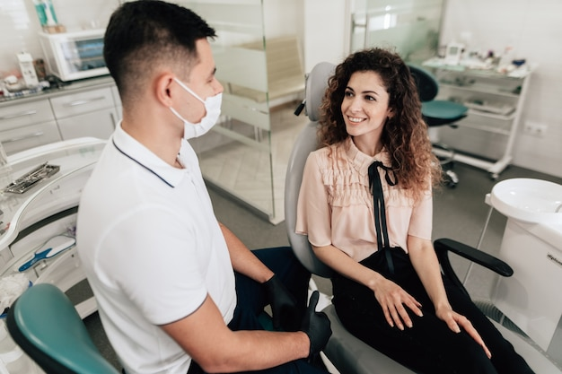 Woman smiling in dentist office Free Photo
