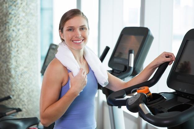 Woman smiling on an elliptical brace Free Photo