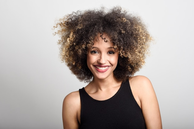 Woman smiling face with curly hair Free Photo