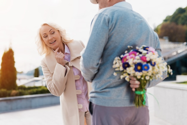 Woman smiling. old couple date. Premium Photo