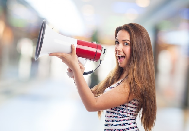 Woman smiling with a megaphone Free Photo