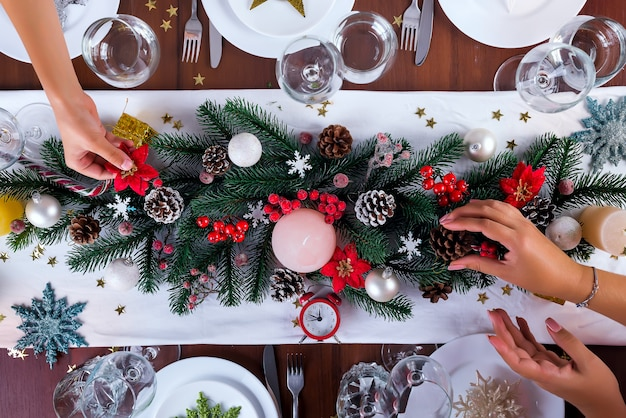 A Christmas Arrangement.A Woman And Son Decorates A Christmas Arrangement With