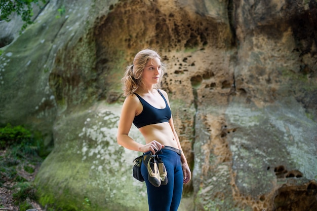 Woman standing in front of a stone rock wall outdoor Premium Photo
