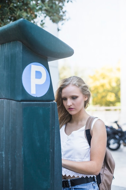 Woman standing near the parking lot at outdoors Free Photo
