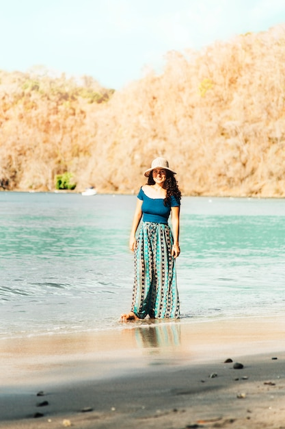 Woman standing on seashore Free Photo