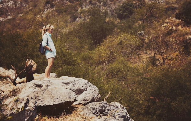 Woman standing on top of a mountain Free Photo