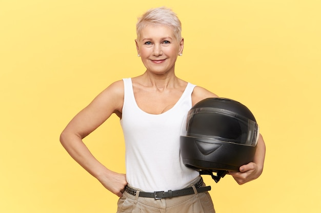 Woman stay with black helmet on yellow Free Photo