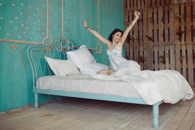 Woman stretching in bed after wake up Free Photo
