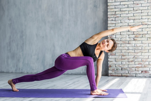 Woman stretching in front with arm extended Free Photo