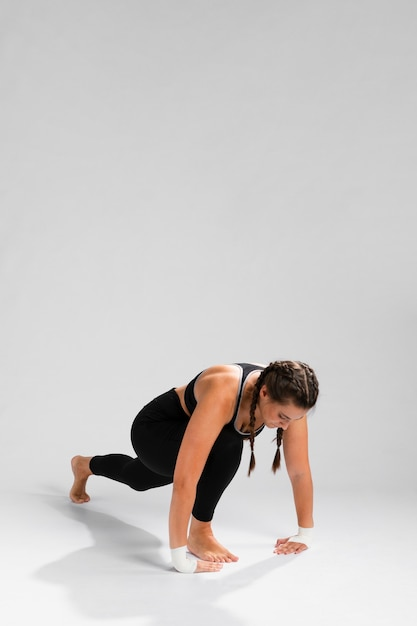 Woman stretching with copy space background Free Photo
