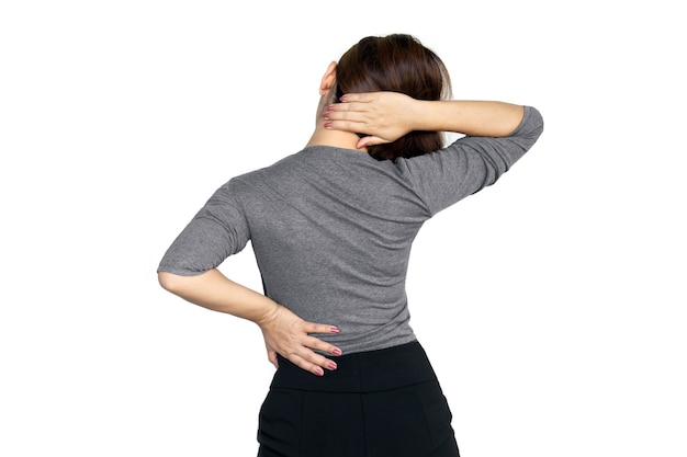 Woman suffering from lower back and shoulder pain Premium Photo