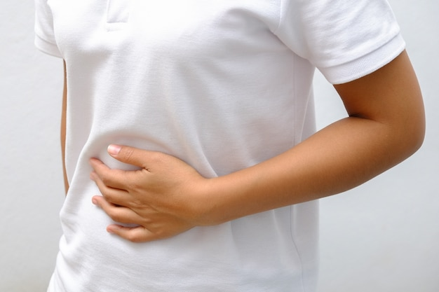 Woman suffering from stomach ache Premium Photo