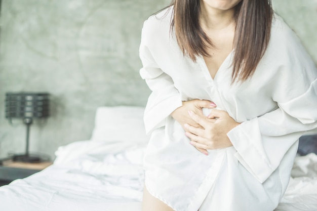 Woman suffering from stomach pain during period Premium Photo