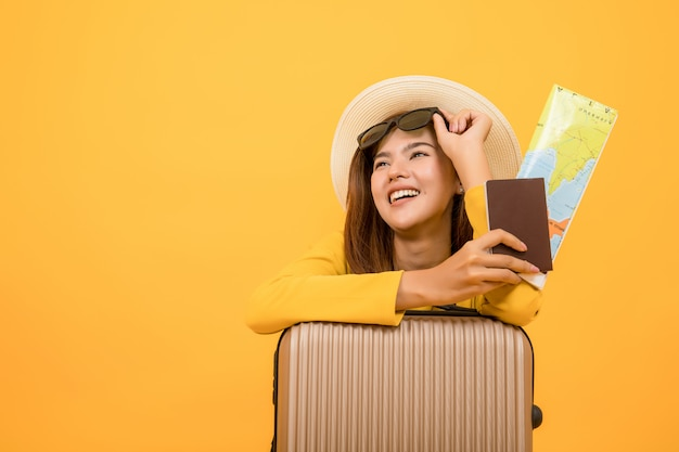 Woman in summer casual clothes, woman holding passport with map, Premium Photo