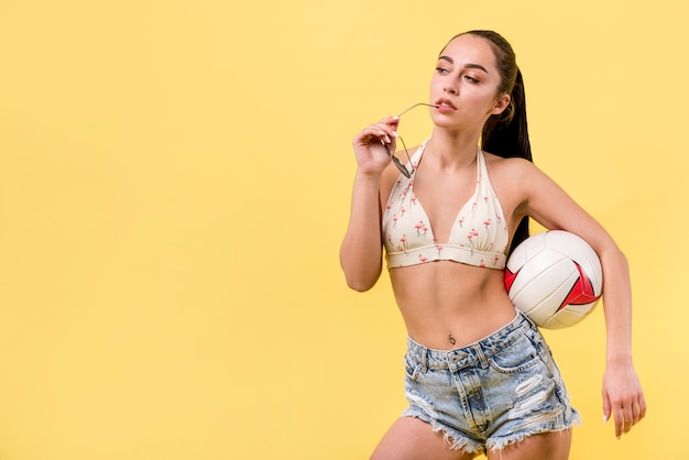 Woman in summer sportswear with ball Free Photo