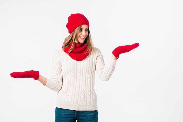 Woman in sweater holding hands apart Free Photo