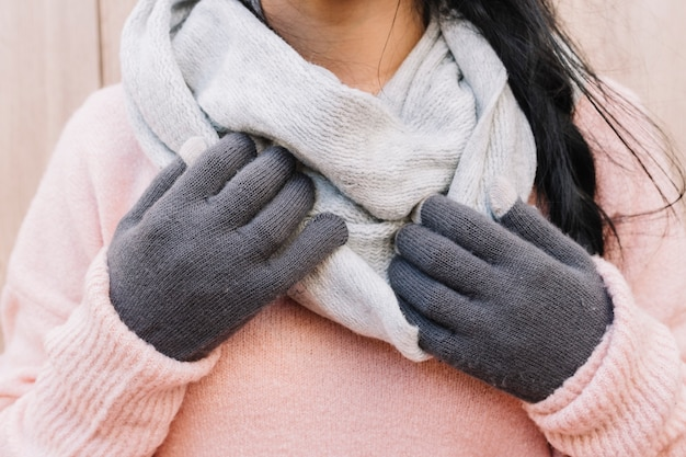 Woman in sweater holding hands on scarf Free Photo