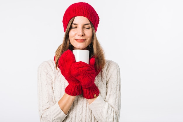 Woman in sweater holding warm cup Free Photo