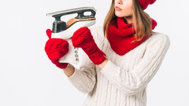 Woman in sweater looking at skate Free Photo