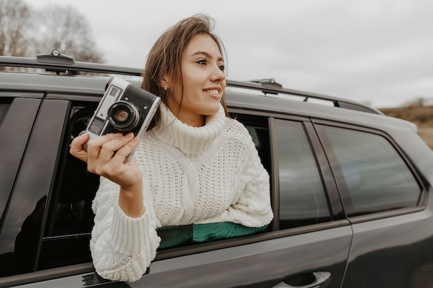 Woman taking head out of window Free Photo