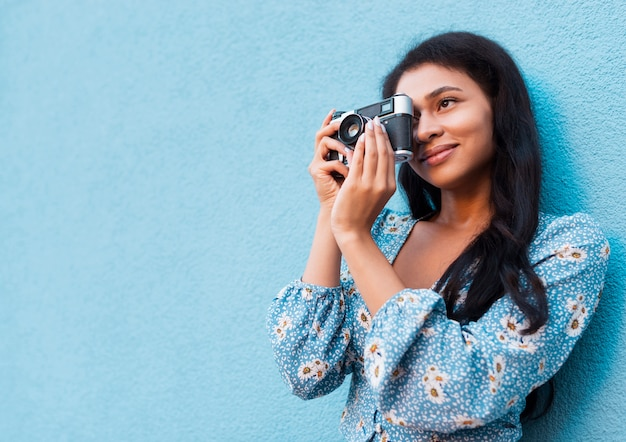 Woman taking a picture with copy space Free Photo