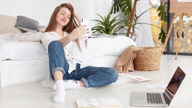 Woman taking a selfie at home Free Photo