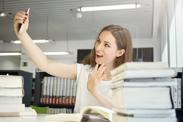 Woman taking selfie photo at office Free Photo