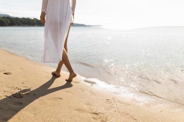Woman taking a walk on beach Free Photo