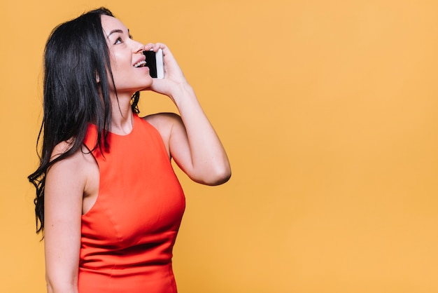 Woman talking by phone Free Photo